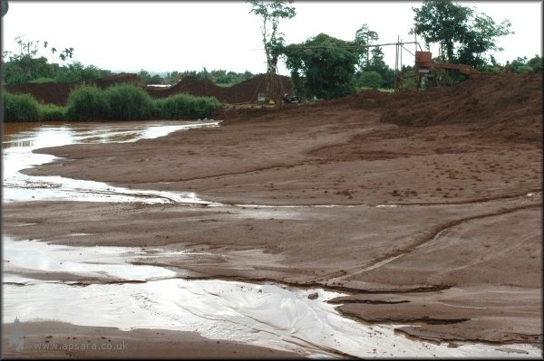After: Six months later, during the monsoon season, the pit has been filled with soil from a new digging.