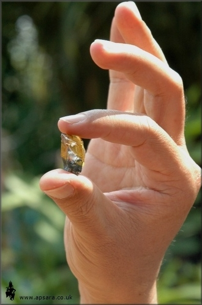 A large golden sapphire crystal.
