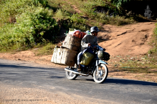 A trader with his motorbike loaded with goods on his way to Mogok...