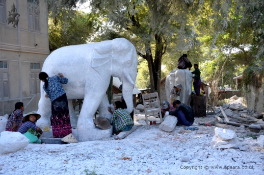 Carving elephants from white marble at Sagyin ...
