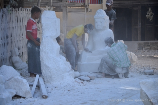 Carving Buddha statues from white marble at Sagyin ...