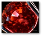 Be-treated orange/red sapphire from Songea.